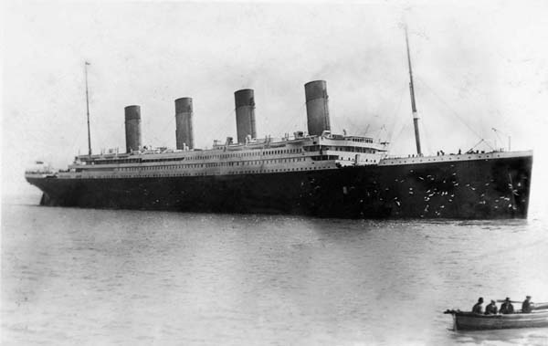 """One of Fr. Browne's last photographs of the Titanic April 11, 1912. A flock of gulls are flying around the Titanic's"""" bow."""