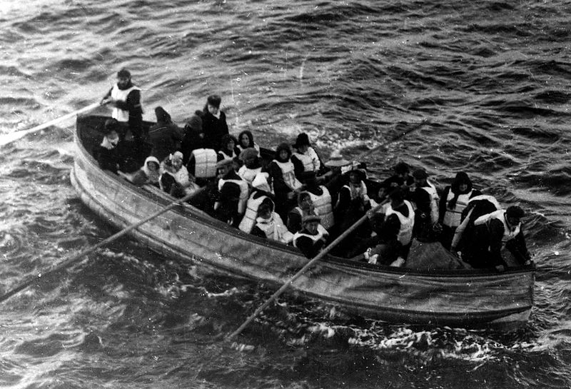 Partially flooded with ice-cold seawater, the Titanic's Collapsible Boat D approaches RMS Carpathia at 7:15 a. on 15 April 1912.